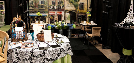 Southern Bridal Show $amp; Expo vendor's booth with displays for brides.